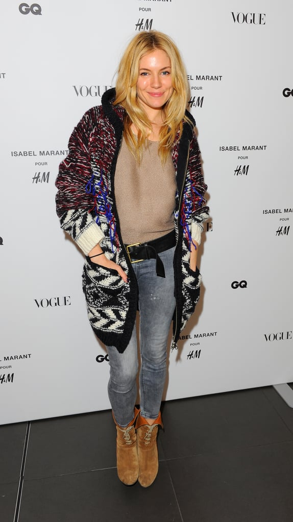 Posing in an Isabel Marant for H&M oversize cardigan, Sienna was the epitome of boho cool during the London preview in November 2013.
