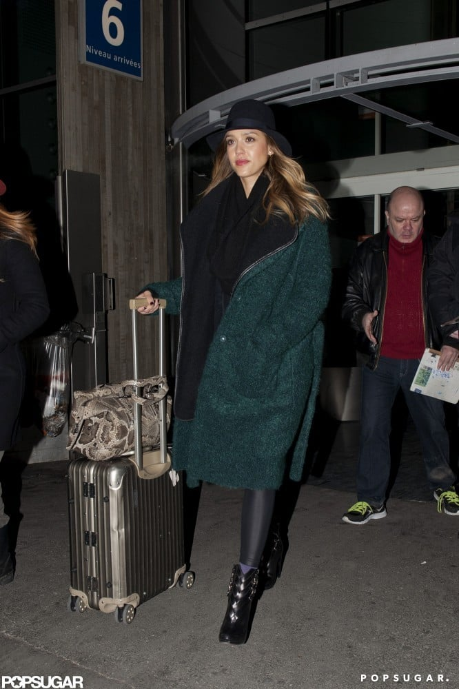 """Jessica Alba arrived at Charles de Gaulle Airport in Paris on Saturday. She wore a green Tory Burch coat and a black hat as she wheeled along her silver Rimowa suitcase through the airport. Jessica's in France to celebrate the birthday of her makeup artist Lauren Andersen. The two ladies went to dinner over the weekend at Les Tablettes de Jean-Louis Nomicos, where Jessica enthusiastically tweeted through her dinner. Of the meal, Jessica said, """"Seriously one of the best dining experiences."""" Jessica and Lauren later joked around when Lauren posted a photo of her and Jessica wearing sheet masks with the caption, """"Jessica, we've never looked better."""""""