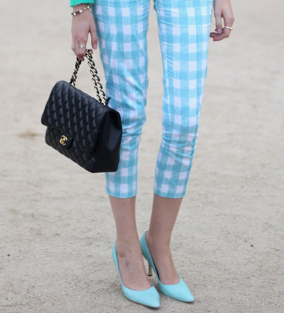 To complement her ladylike gingham, she donned pastel blue pumps and a quilted black Chanel purse.