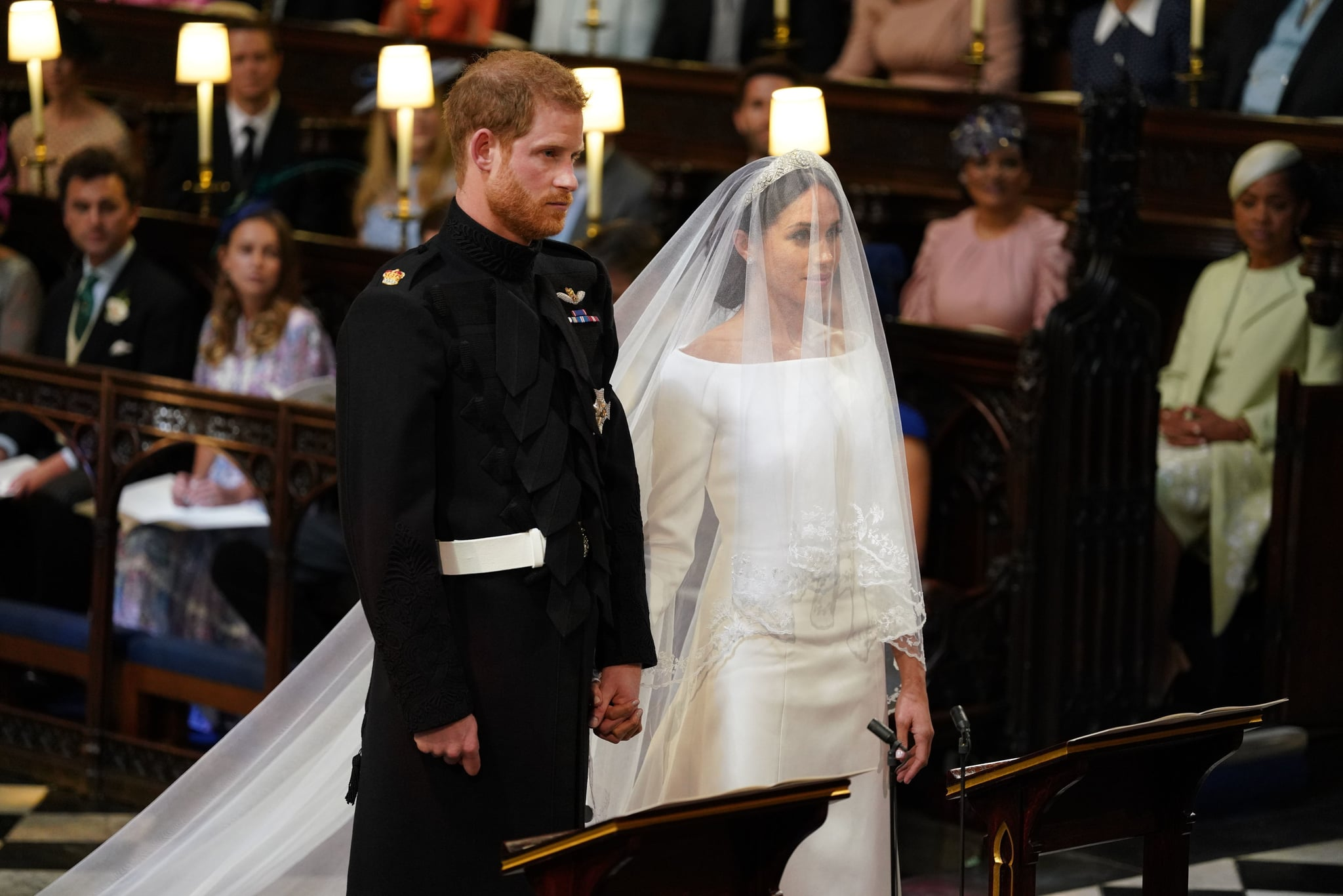 Britain's Prince Harry, Duke of Sussex (L) and US fiancee of Britain's Prince Harry Meghan Markle stand together for their wedding in St George's Chapel, Windsor Castle, in Windsor, on May 19, 2018. (Photo by Dominic Lipinski / POOL / AFP)        (Photo credit should read DOMINIC LIPINSKI/AFP/Getty Images)