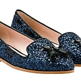 One part schoolgirl, one part glitter explosion — we're kind of obsessed with it all. Miu Miu Glitter Slipper With Tassels ($495)