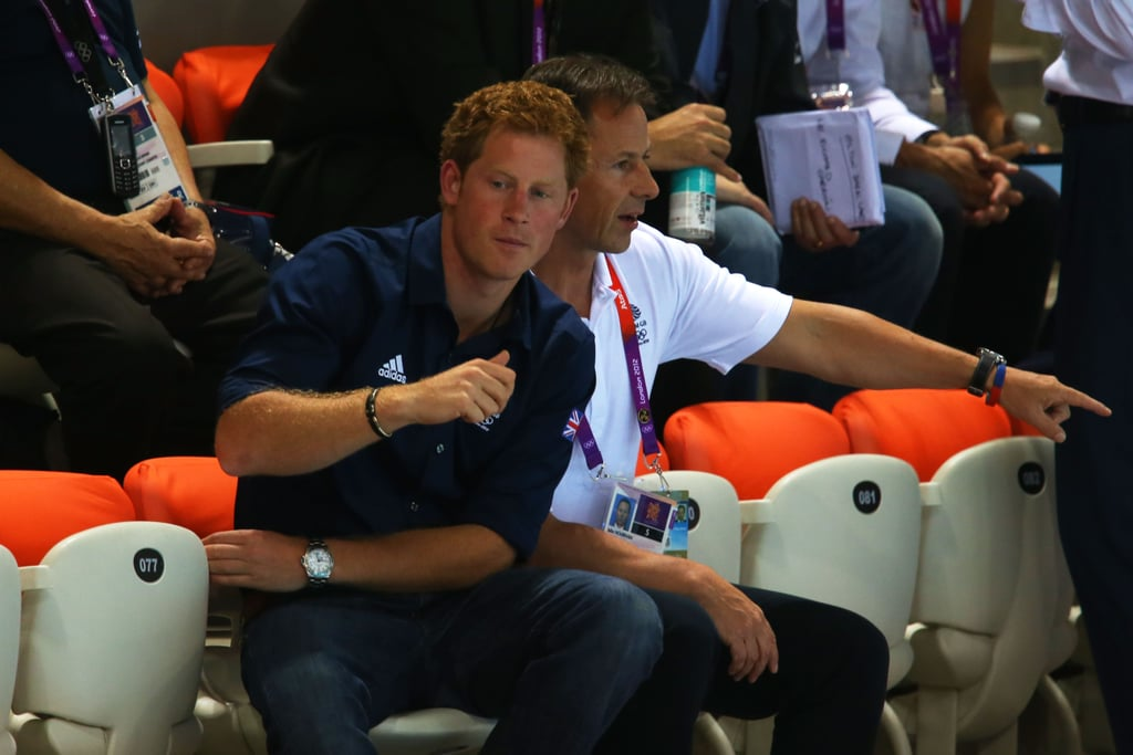 Prince Harry rooted during the swim meet at the Olympics.