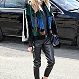 Olivia added interest to all black with a printed furry jacket, skinny scarf, and Westward Leaning shades.