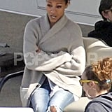 Zoe Saldana kept warm in a chunky sweater.