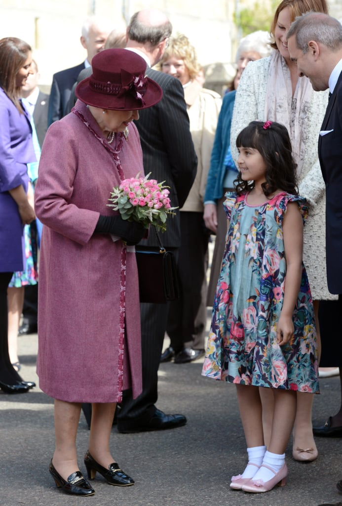 Queen Elizabeth ll met a little girl during a walkabout to mark her Diamond Jubilee on April 30 in Windsor, England.