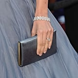 Penelope Cruz added an understated clutch and a pretty diamond bracelet to her Oscar-night ensemble.