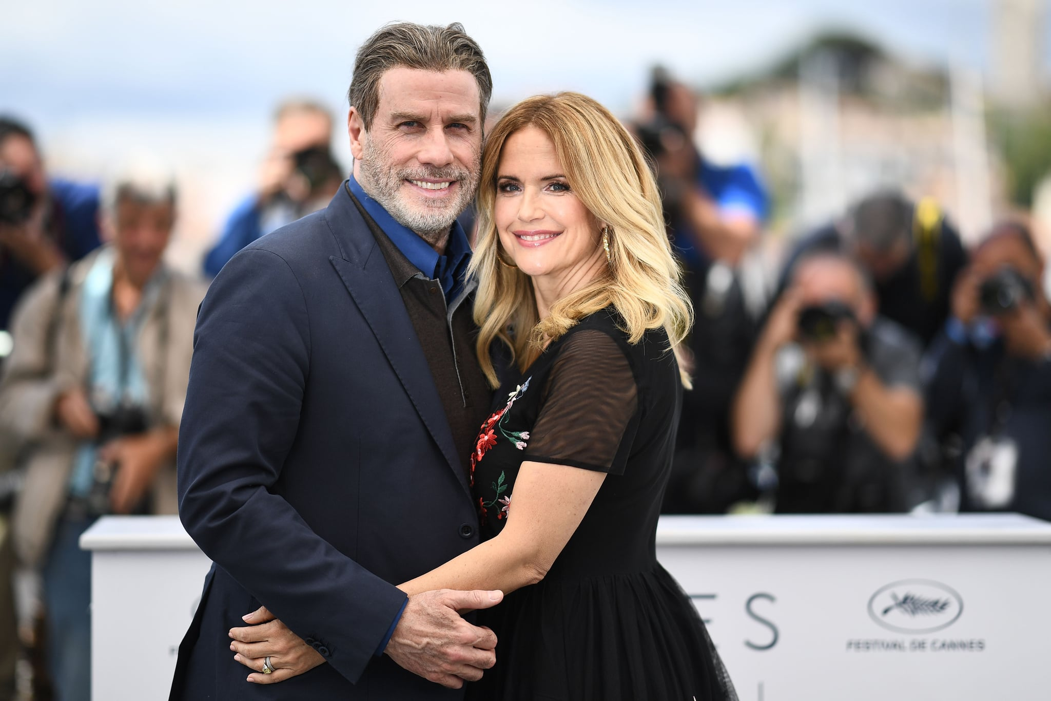 TOPSHOT - US actor John Travolta (L) and his wife US actress Kelly Preston pose on May 15, 2018 during a photocall for the film
