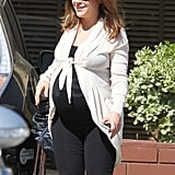 Alyssa Milano flashed a smile the day before giving birth.