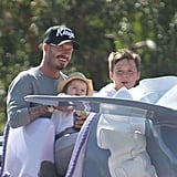 Harper Beckham sat on dad David Beckham's lap with brother Brooklyn Beckham next to them on a ride at Disneyland.
