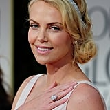 If you don't have a jewelled headband like Charlize Theron's, you could use a necklace, pinned at the nape of the neck. Ensure you use enough kirby grips to keep it in place, especially if it's heavy.