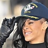 Rihanna laughed while she covered her new dark hair with a hat at a Battleship photocall in Japan.