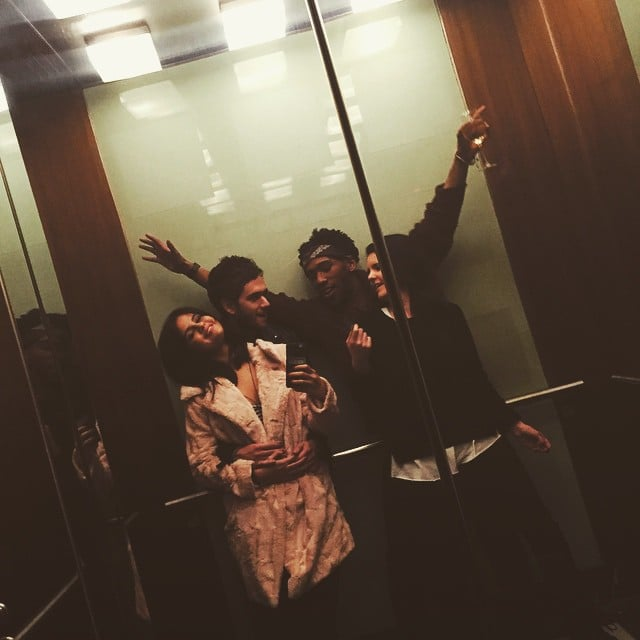 This elevator selfie captures their fun night with pals.