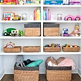 "Problem: I organized every square inch of the playroom, but no one is respecting my system! Solution: ""The biggest mistake people make with toy storage is being overly specific,"" The Home Edit pros told POPSUGAR. ""If you create microcategories, it'll be difficult for kids — and even adults! — to clean up and maintain the organization."" Instead of separating out smaller Legos from larger Duplos, for instance, consider allowing for more interpretation in where things belong. ""Creating broad categories that kids intuitively understand — blocks, dolls, dress-up, and so on — will help with long-term maintenance and keep your home neat."" Problem: Sure, my kids love the setup, but it's an absolute eyesore. Solution: The most important part of a playroom is that it fosters play, but if it can also be an appealing space for parents to spend time, all the better. ""Organizing according to the rainbow helps create a playful and creative space for kids and a stylized space for adults,"" Clea and Joanna said. ""Arrange the books, art supplies, toys, and pretend food by color, and you'll not only have a pretty playroom, but your kids will automatically know where everything is stored."" Don't feel guilty about adopting the ROYGBIV aesthetic: ""The rainbow system has the extra bonus of turning clean-up into a color sorting activity — it's a win-win for the entire household!"""