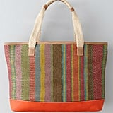 Batik-inspired stripes in tropical hues pair well with braided rope straps and sleek leather trim.  Loft Woven Straw Tote ($60)
