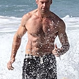 Hugh Jackman had a shirtless beach outing in Sydney.