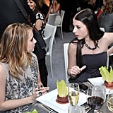 Emma Roberts and Michelle Trachtenberg share a moment over apps.