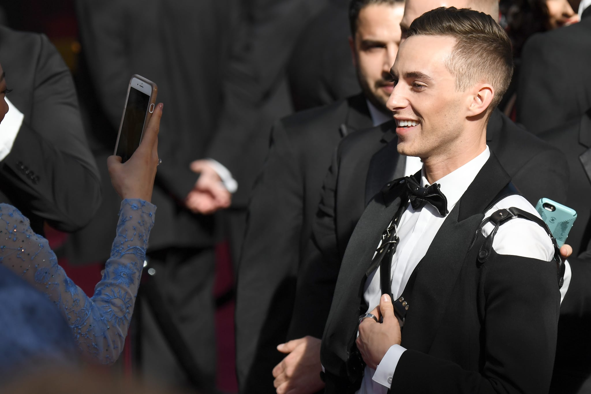 US Olympic medalist Adam Rippon (R) arrives for the 90th Annual Academy Awards on March 4, 2018, in Hollywood, California.  / AFP PHOTO / Robyn Beck        (Photo credit should read ROBYN BECK/AFP/Getty Images)