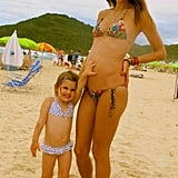 Pregnant Alessandra Ambrosio posed in a bikini with her daughter, Anja, in December 2011.