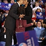Then Senator Barack Obama gets a hug and kiss from Michelle at a rally in Iowa.