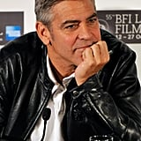 George Clooney listened at a press conference.