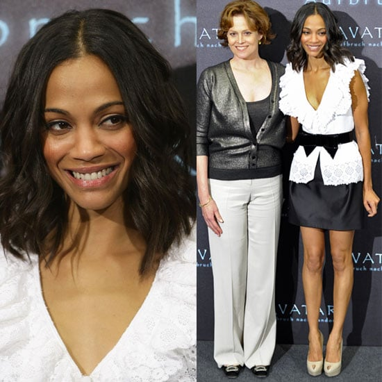 Zoe Saldana Wears White Ruffle Blouse and Bow Belt at Avatar Photo Call in Germany