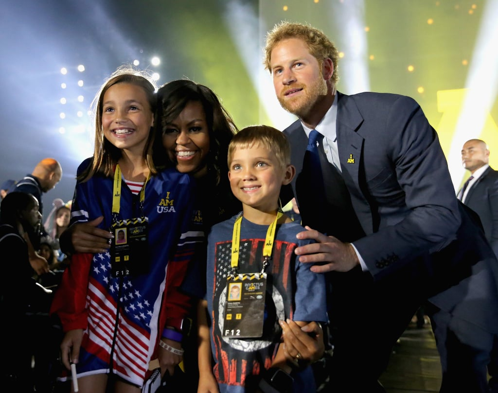 Michelle joined Prince Harry at the opening ceremony of the Invictus Games in May, where they struck a supercute pose with two young fans.