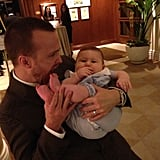 "Aaron Paul snapped a picture with the ""very healthy baby"" that he met at one of the pre-Golden Globes parties. Source: Instagram user glassofwhiskey"
