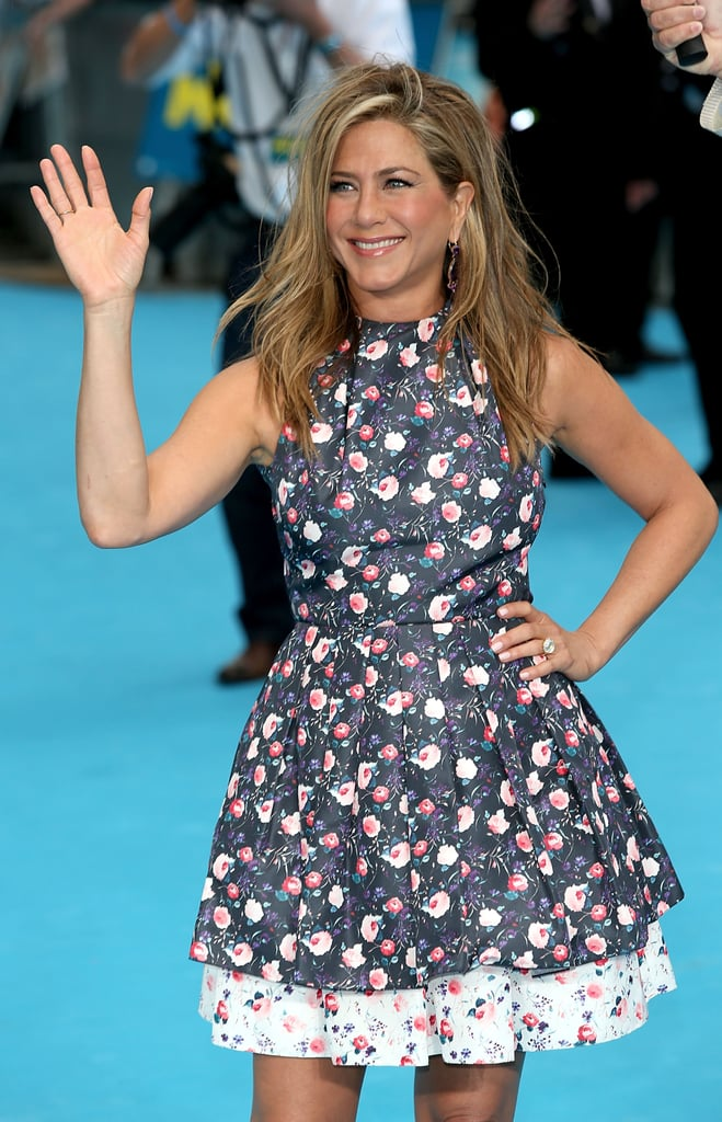 Jennifer Aniston waved to fans on the red carpet at the London premiere of We're the Millers.