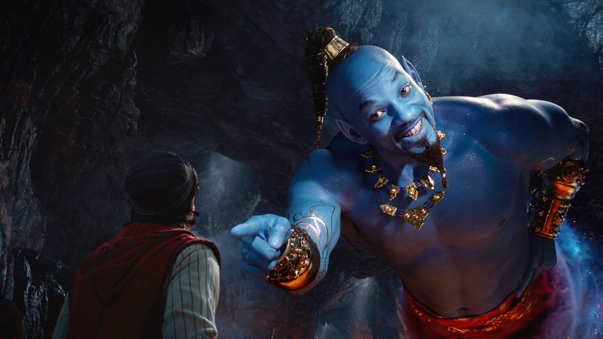 ALADDIN, from left: Mena Massoud as Aladdin, Will Smith as the Genie, 2019.  Walt Disney Studios Motion Pictures / courtesy Everett Collection