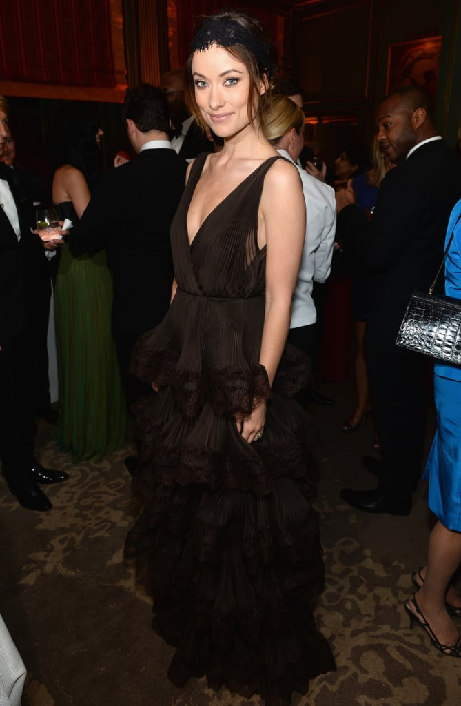 Olivia Wilde also stepped out for Bloomberg and Vanity Fair's reception in a lace-trimmed, tiered black gown and coordinating headpiece.