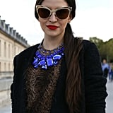 Metallic shades and a blue jeweled statement necklace punched up print and a blazer.