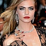 Cara Delevingne attended the Great Gatsby premiere during the Cannes Film Festival wearing a classic red manicure that would look just as glamourous with a white lace gown.