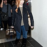 Jessica paired a no-fail black peacoat with an olive tee, jeans, and sexy black knee-high boots. While the shoes may provide the attitude, the outerwear ties it all together.