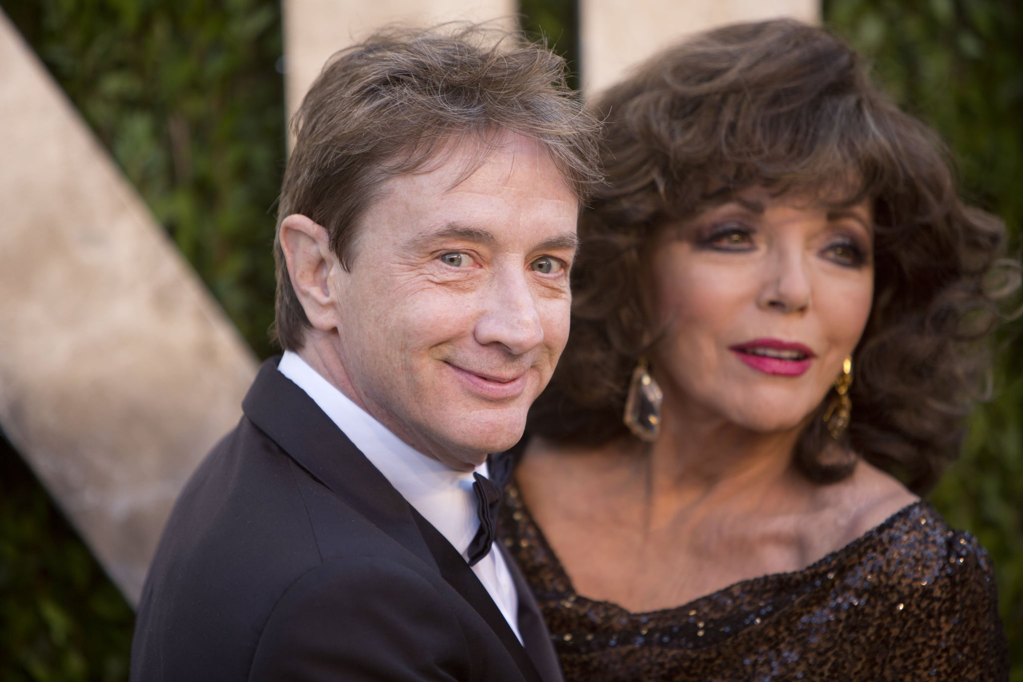 Martin Short and Joan Collins arrived at the Vanity Fair Oscar party on Sunday night.