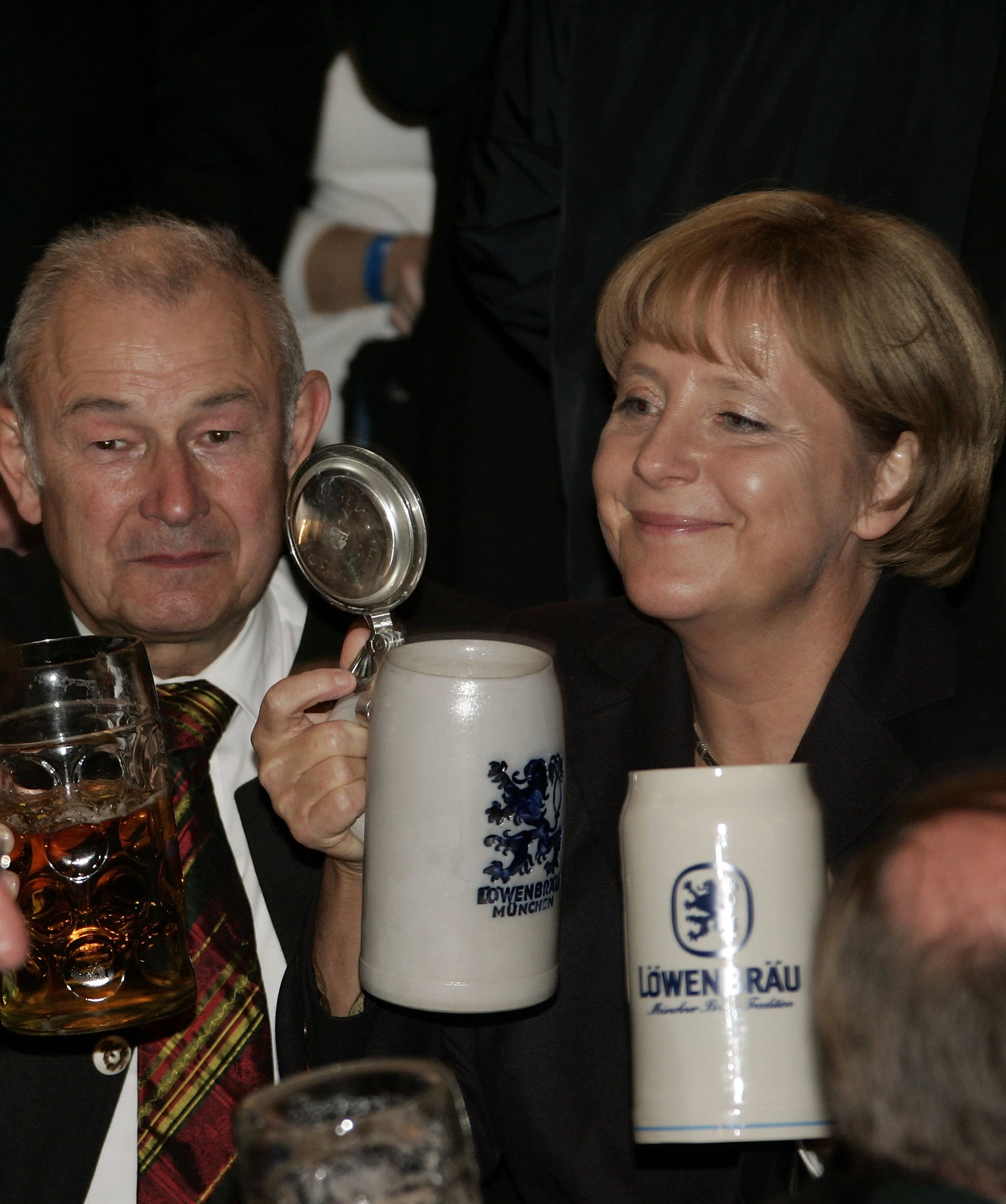Bavaria's state governor Guenther Beckstein and German Chancellor Angela Merkel
