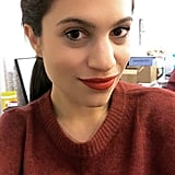 """Somehow with minimal makeup, greasy hair, and a baggy sweater, this lipstick made me feel sexy and sassy. It spread to fill in all of my lips, making my pout appear naturally plumper. I'm also really sensitive to dry liquid lipsticks (for example, I can't wear Kylie Lip Kit formulas). And while this was smooth and matte, it did not feel uncomfortable at all. I love the bright-red shade against my medium-light complexion."" — Lauren Levinson, senior editor, Beauty"