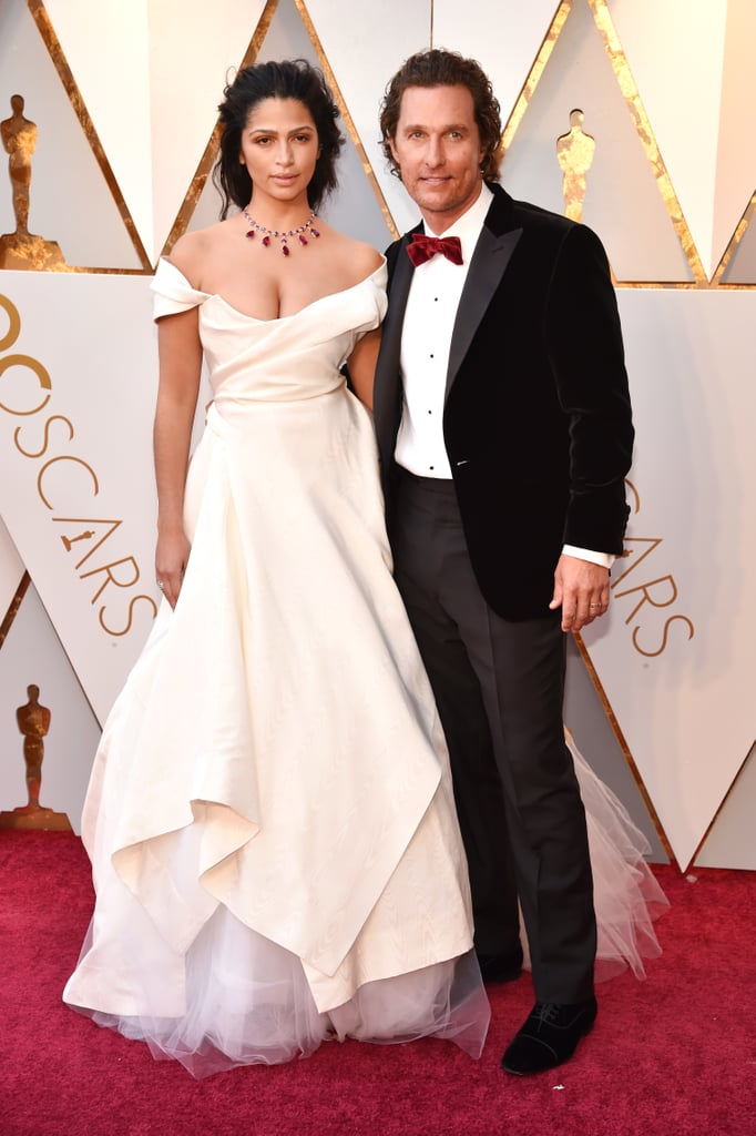 """If you've missed seeing Matthew McConaughey and Camila Alves together, take a deep breath. On Sunday, the couple made a glamorous appearance at the Oscars. Camila turned heads in a gorgeous white gown, while Matthew looked way more than alright in his tux and Persol sunglasses — don't they look like they're getting married again? To make matters even cuter, the couple linked up with Matthew's Interstellar costar, Timothée Chalamet, and yes, their reunion was as cute as you'd expect.  Prior to their arrival, Camila posted a sweet Instagram snap of her and Matthew. """"On our way . . . #academyawards #oscarswriting,"""" she captioned it.           View this post on Instagram            A post shared by Camila Alves McConaughey (@camilamcconaughey)   The last time Matthew and Camila hit a red carpet together was at the NYC premiere of The Dark Tower back in July 2017. Luckily, Camila often shares photos of her and her husband on social media. Oh, how we've missed these two!      Related:                                                                                                           These Celebrity Couples Prove Love Was Definitely in the Air at the Oscars"""