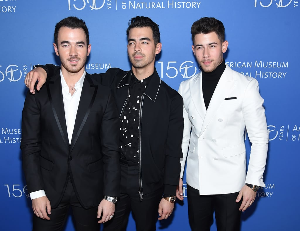 "The Jonas Brothers have been everywhere ever since they got back together earlier this year, and they're showing no signs of slowing down. On Thursday night, Nick, Joe, and Kevin took a break from their Happiness Begins tour and popped up at the annual American Museum of Natural History Gala in NYC. The trio dressed to impress in color-coordinated black and white ensembles, and man, did they look good.  The Jonas Brothers's latest appearance comes just a day after they received their first Grammy nomination since 2009. The band is nominated for best pop duo/group performance for ""Sucker,"" and naturally, they lost their cool over the special honor. ""There were some really tough moments that had to happen for us to get to this place but it's right where we are supposed to be. This has truly been our greatest year yet,"" the brothers wrote on their Instagram. ""We truly couldn't be happier . . . as artists, as friends, and as brothers. To think a year ago we hadn't even released music . . . This nomination means the world."" Find out if they win when the Grammys go down on Jan. 26."