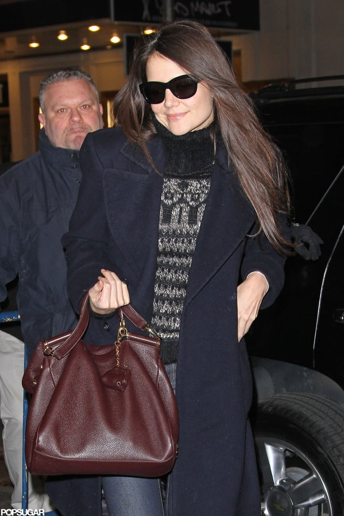 Katie Holmes wore a turtleneck sweater to her Broadway show.