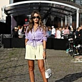 Style Yellow Shorts With White Heels and a Purple Top