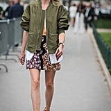 Hack: Unbutton your white top beneath a shorter bomber jacket to add some feminine pleating to your look and break up a busy print. Push up your sleeves when it's warm.