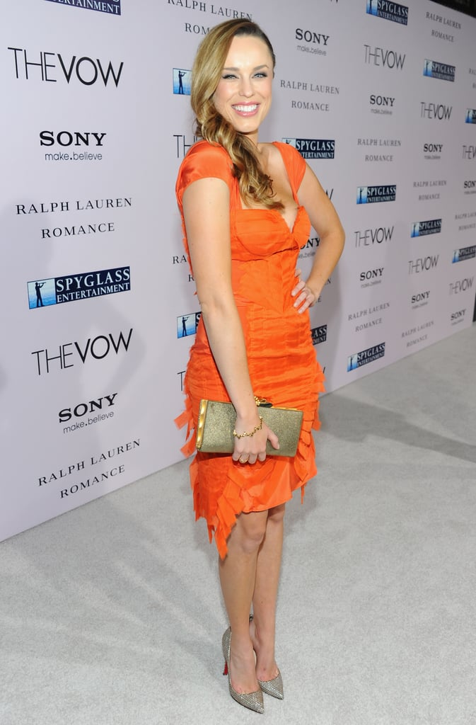 Jessica McNamee in bright orange at the premiere of The Vow.