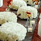 Don't let your eyes deceive you, these floral centerpieces aren't as simple as bursting white arrangements — those are molecular models.  Source: Mariana Mosli, Kismisink Photography