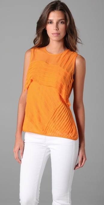 We love the look of this bright, Springy-hued top for work or play.  Nanette Lepore Tuckered Out Top ($278)