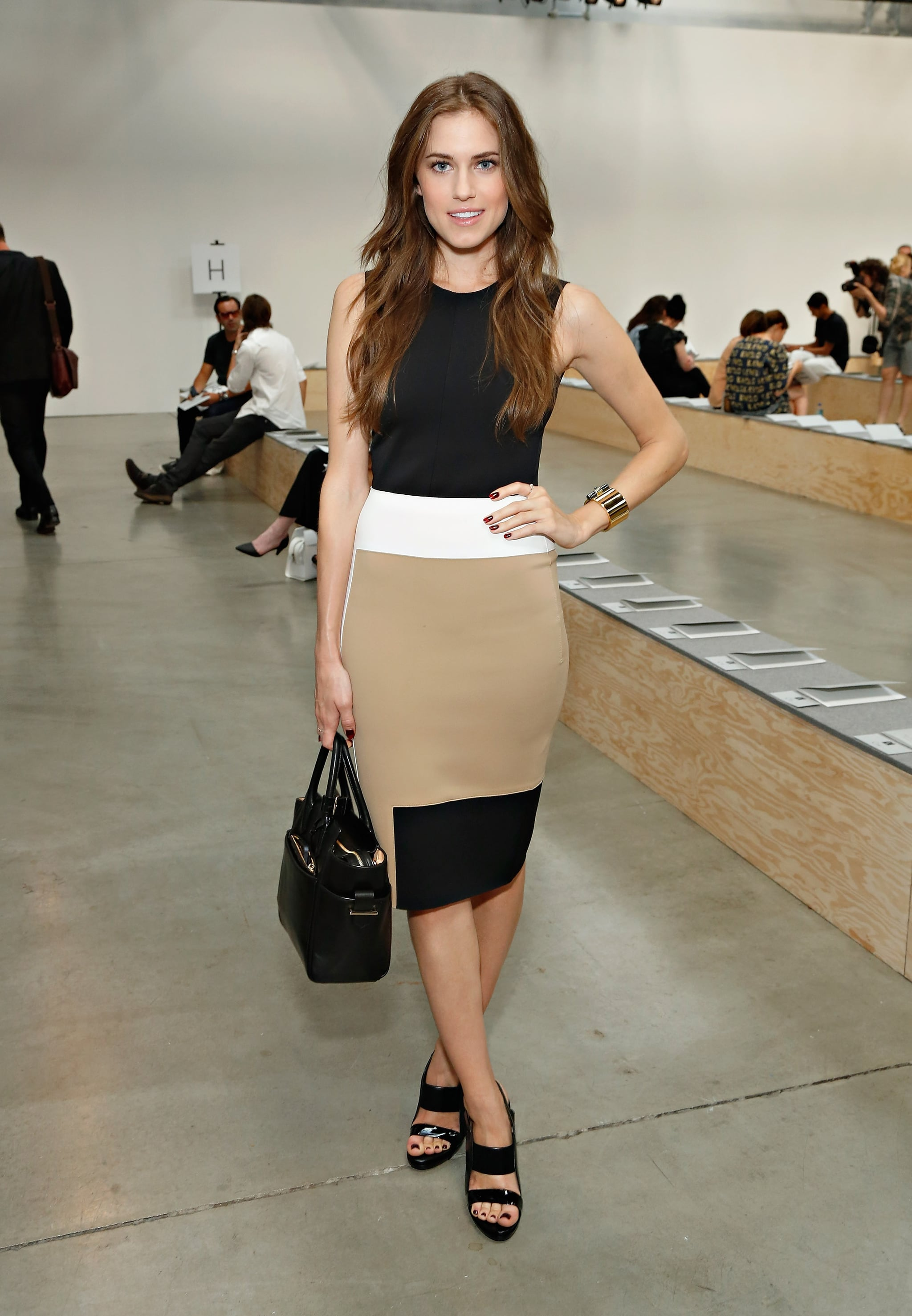 Allison Williams stuck to a trio of chic hues — beige, black, and white — at the Reed Krakoff show.