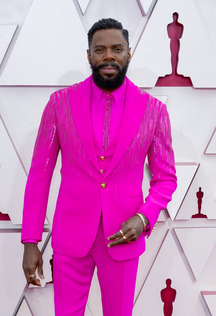 """Colman Domingo sure knows how to make a fashion statement on the red carpet. During the Oscars on April 25, the Ma Rainey's Black Bottom actor pulled up to the show looking like an absolute ray of sunshine in a stunning hot pink suit. Colman shared in his Instagram Stories that he was wearing custom Versace """"for the culture."""" He was one of the first to arrive during the Sunday night show, and we're so glad because it gave us extra time to see all the stunning details throughout Colman's outfit. The suit is adorned with gold buttons and 4,500 Swarovski crystals and sequins down the jacket and shirt. He wrote on social media that the embroidery took 150 hours to complete! Colman is hosting the official Oscars: After Dark post-show following the ceremony alongside Andrew Rannells, so we have a lot more of Colman to look forward to seeing. Check out photos of his fabulous red carpet look ahead.      Related:                                                                                                           64 Iconic Oscars Looks So Beautiful, They Deserve an Award of Their Own"""