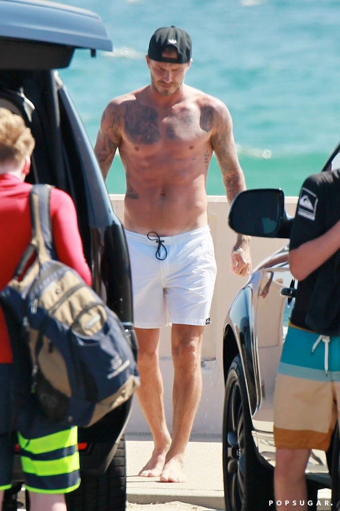 "David Beckham put his incredible body on display on Thursday when he stopped by a beach in LA with his family. The retired soccer star was in the middle of a fun day with his boys, which also included a stop by the LA Dodgers game against the Atlanta Braves later that day. The Beckhams are familiar faces in the stands at sporting events — whether it's hockey, soccer, or baseball games — and David made sure to get cute while cuddling with his son Romeo. Victoria Beckham was not with her family during their outings, but she did share some inspirational words on her Twitter account. She wrote: ""'Unlock somebody's greatness with your words,' Make someone feel AMAZING today x happy Thursday."" This is hardly the first time we've seen David shirtless, but it's always great to see him flaunting his athletic frame. David's abs were on display earlier this Summer when he starred in steamy new underwear ads for his line for H&M. Of course, if you want more of David, you can check out our roundup of his hottest shirtless pictures."