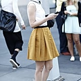 A ladylike blouse and skirt were offset with menswear-inspired footwear. Source: Greg Kessler