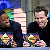 Ryan and Denzel read cards to each other.