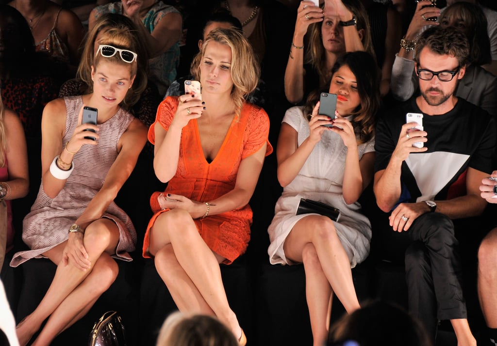 The snap-happy front row at Wednesday's J.Mendel show consisted of model Jessica Hart, Molly Sims, Melonie Diaz, and Brad Goreski.